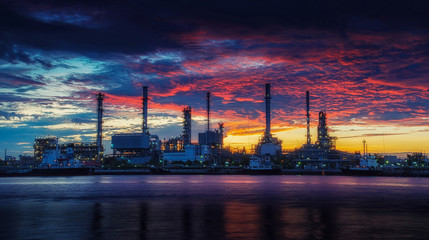 oil refinery industry plant along twilight morning.