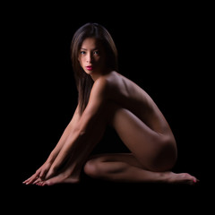Nude pose on black