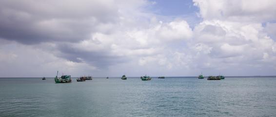 Cambodian fishing boats/Cambodian fishing boats on calm sea