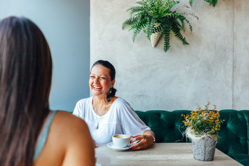Two women talking in cafe