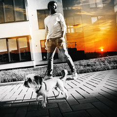 a man with a dog and sunset, double exposure
