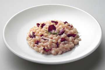 Dish of risotto with red radicchio