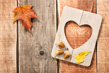 Autumn background with frame heart shaped