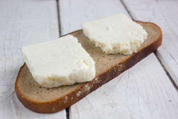 Traditional indian cheese panneer with pieces of bread