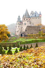 Autumn Burresheim Castle with topiary green trees in ornamental