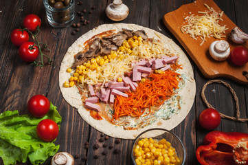 Cooking tortilla wraps with ham, corn, cheese, mushrooms and carrot