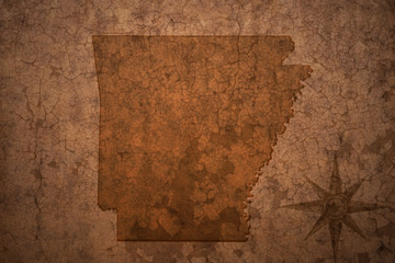 arkansas state map on a old vintage crack paper background
