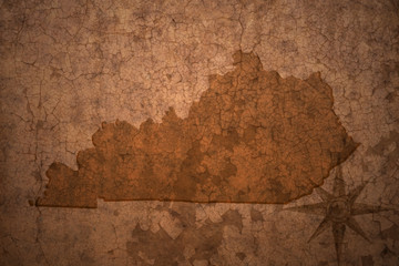 kentucky state map on a old vintage crack paper background