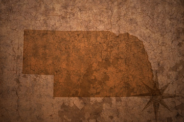 nebraska state map on a old vintage crack paper background