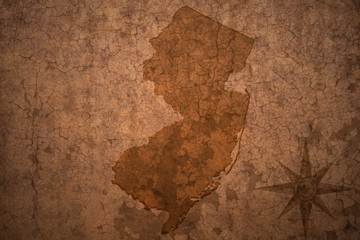 new jersey state map on a old vintage crack paper background