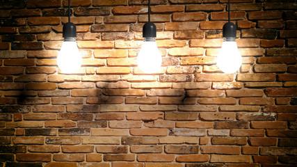 Light bulbs on brick wall background. 3d illustration