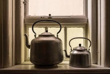 Tea kettles in a window in Norway.