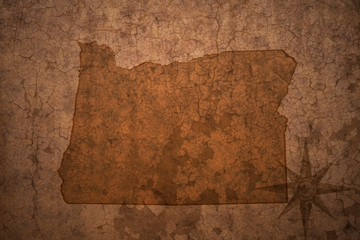 oregon state map on a old vintage crack paper background