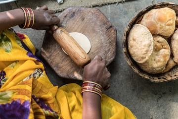 Making handmade roti bread in India.