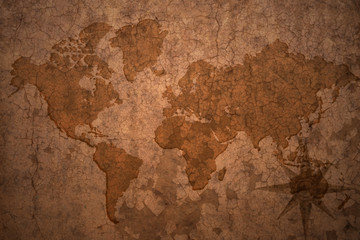 world map on a old vintage crack paper background