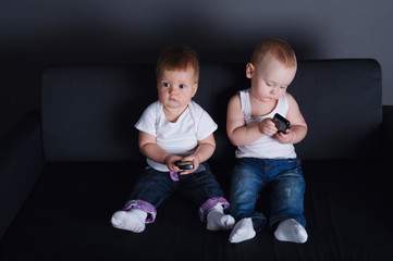 cute children with mobile phones