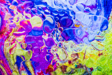 Image Water drops on glass pane in vibrant abstract colors