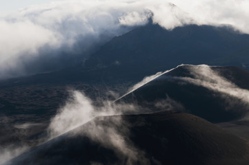 Morning clouds begin to burn off of Haleakala National Park; Maui, Hawaii, United States of America