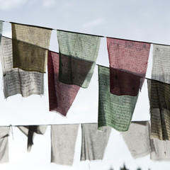 Prayer flags hanging on a line in the city of Thimphu, Bhutan, Asia