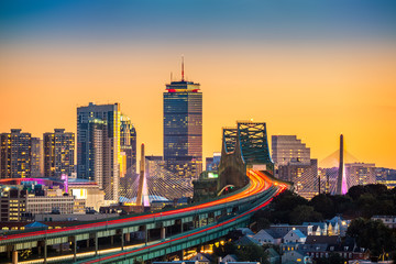 Wall Mural - Rush hour traffic on Tobin bridge (aka Mystic River bridge) heading towards Zakim bridge and Boston skyline at sunset.