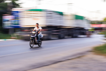 motorcycle panning in road, Asia