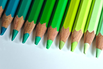 High Angle View Of Colored Pencils Arranged On White Table