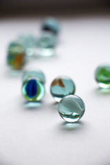 Close-Up Of Various Marbles On White Background