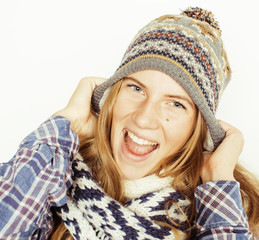 young pretty blond teenage girl in winter hat and scarf on white background smiling close up isolated