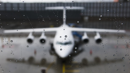 View of the front of an aircraft through a wet window; Munich, Germany