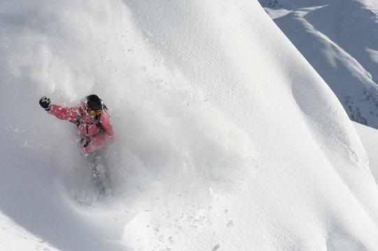 Snowboarding in powder snow; St. Moritz, Graubunden, Switzerland