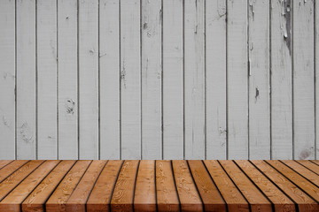 Grunge vintage wooden board table in front of old wooden background