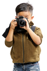 Asian boy using a camera on a white background.isolated