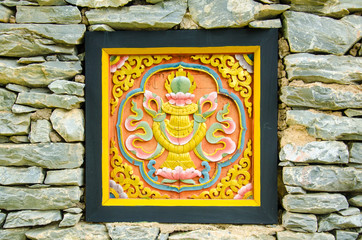 Bhutan Art  Carve on the Stone Wall