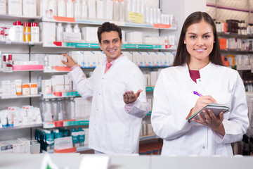 Two pharmacists in modern pharmacy