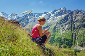 girl with mobile phone in the mountains
