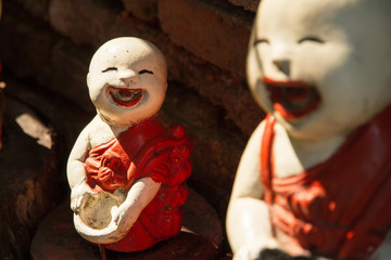 Novice buddhist clay dolls, Happiness concept.selective focus