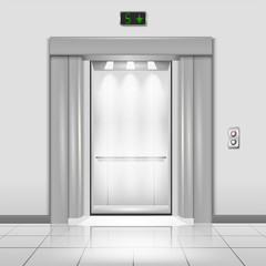 Closed chrome metal office building elevator doors with rays of