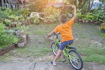 Joyful child on bicycle in park