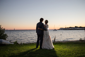 sunset bride groom couple love together mackinac island