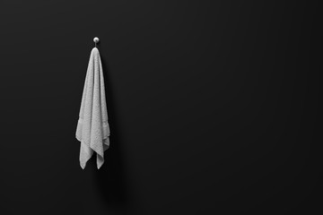 3D rendering : illustration of a piece of clean and white towel hanging on a matt black wall,light and shadow,copy space,3d rendering,dark edges