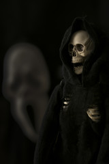 grim reaper, Halloween death character against black background with scream face
