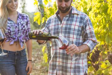 Couple Tasting Wine in Vineyard
