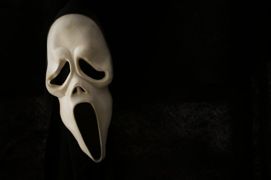 Scary scream Halloween face against black background