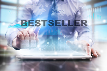 """Businessman is using tablet computer, pressing button on touch screen and selecting """"Bestseller""""."""