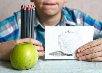 apple and drawing in kids hands