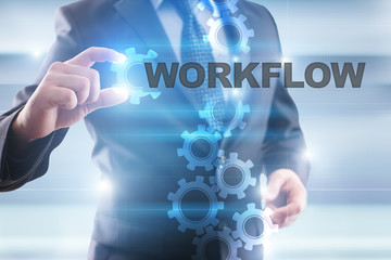 """Businessman is selecting """"Workflow"""" on the virtual screen."""