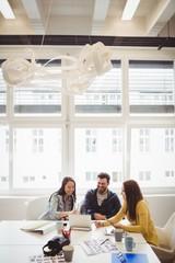 Business people using laptop in meeting room