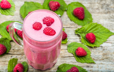 Healthy smoothie, fruit milkshake, raspberry heart with foam