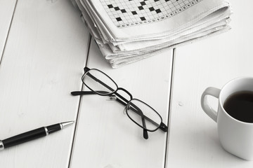 Crossword and pencil on wooden background