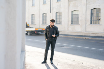 young man bearded outdoor using smart phone